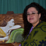 Marind van Vuuren with one of her paintings.